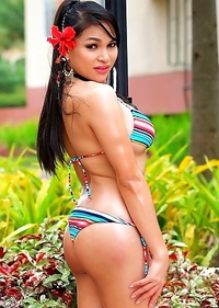 Big Boobs TS Filipina posing outdoors in bikini