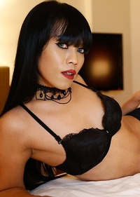 25yo sexy Thai ladyboy Yammy poses before taking white cock hard up her ass