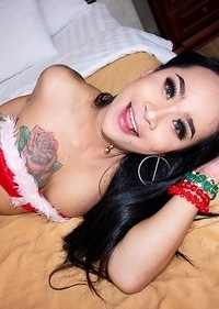 Ladyboy Anna is in the holiday spirit in a Christmas bikini with white boots and reindeer antlers.