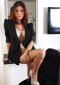 A Sophisticated Asian babe showing her tits and erect dick