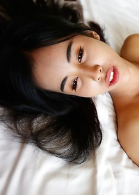 19 year old sweet looking Thai ladyboy Nene takes facial from big white cock