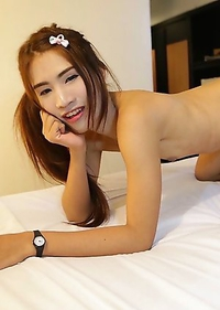 21 year old Thai ladyboy Donut stripps and teases white cock