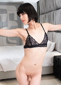 Yoko is showing off her hard cock in this delicious piece of black lingerie