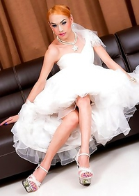 Ladyboy Jacky is horny and sprung with anal play in her wedding dress
