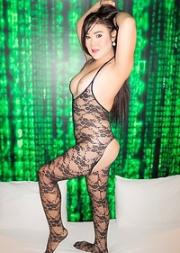 Wearing crotchless black bodysuit lingerie Anny pleasures herself with a swirling vibrator. Anny poses, displaying her voluptuous figure.