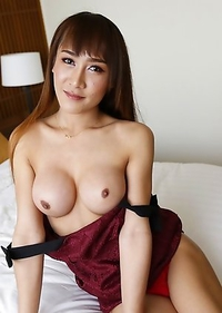 Big tits Thai ladyboy Mos does a striptease and sucks off white cock