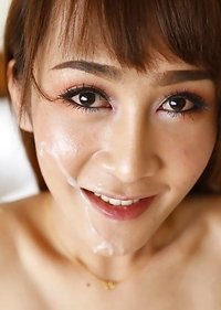 Busty Thai shemale Mos gets naked and sucks fucks and gets a facial from white cock