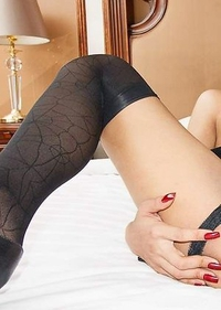 Many tight slender body is wrapped in a black body stocking with a cute little tie and mini skirt.