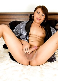 Big booty Ladyboy Dao strokes her cock in a kimono