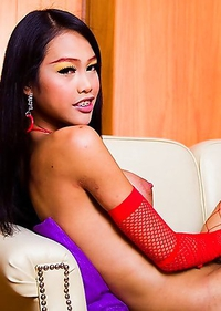 Cheeky Ladyboys Moo and Wawa play together in sexy lingerie