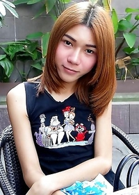 19 year old shy Thai ladyboy May gets naked and does a striptease