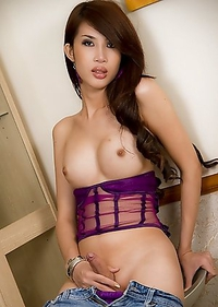 Ladyboy Ne reveals her sexy package in blue jeans