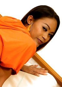 Coloful leggings and an orange hoodie for hung Kathoey Jasmine